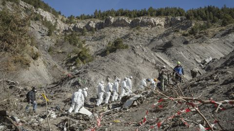 French emergency rescue services work among debris of the Germanwings passenger jet at the crash site near Seyne-les-Alpes, France on Friday, April 3.
