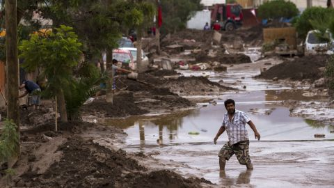 A man wades through a flooded street in Copiapo on March 30.