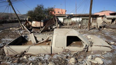 A pickup truck sits encased in mud in Diego de Almagro on March 28.