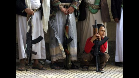 A Yemeni boy holds a rifle as Houthi supporters attend a rally in Sanaa, Yemen, on Sunday, April 5, protesting airstrikes carried out by a Saudi-led coalition against Houthi rebels.