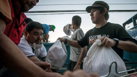 Volunteers distribute bags at a relief center in Copiapo on Wednesday, April 1.