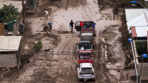 People cross a flooded street in Copiapo on March 30.