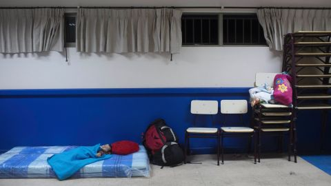 A boy sleeps on a mattress at a school in Chanaral on March 26. Fears of mudslides prompted authorities to evacuate thousands from their homes.