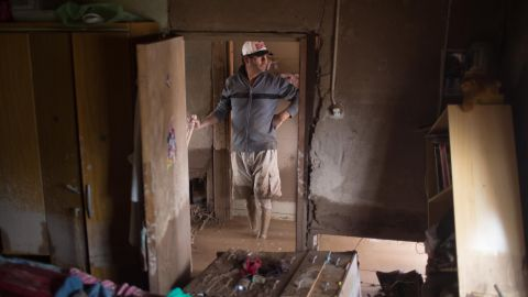 A man cleans his flooded home in Copiapo on March 26.