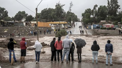 Residents watch rising floodwaters in Copiapo on Wednesday, March 25.