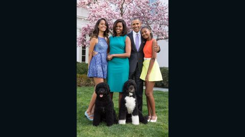 The President, first lady Michelle Obama and their daughters, Sasha and Malia, pose with Sunny and Bo on Easter Sunday in April 2015.