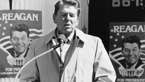 """Reagan makes a speech during the Republican presidential primary in New York in March 1980. Behind him are campaign posters with one of his most famous slogans: """"Let's make America great again."""""""