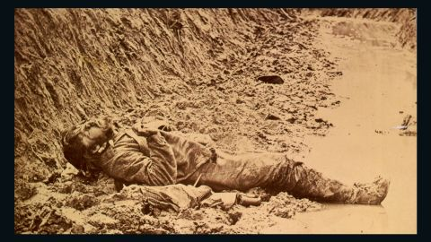 A dead Confederate soldier in the trenches of Fort Mahone in front of Petersburg, Virginia, on April 3, 1865.