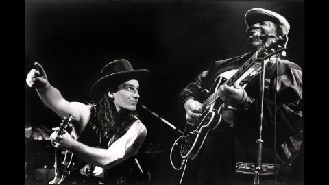 """King and Bono of U2 perform in Rotterdam, Netherlands, in 1990. King recorded the song """"When Love Comes to Town"""" with the band."""