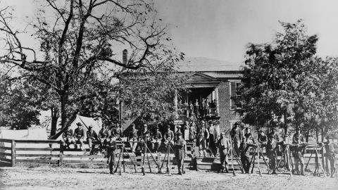 Union soldiers pose in April 1865 in front of Appomattox Courthouse.