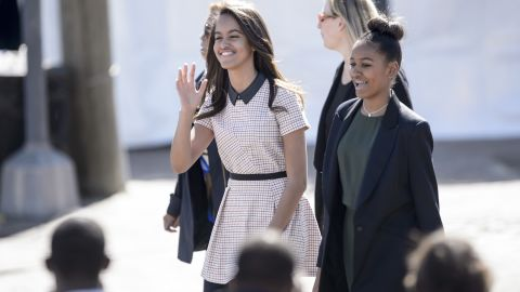 """Malia and Sasha arrive at the Edmund Pettus Bridge in Selma, Alabama, in March 2015. The Obamas were in Alabama to commemorate the <a href=""""http://www.cnn.com/2015/03/08/us/selma-50-years-anniversary-live-events/"""">50th anniversary of Bloody Sunday</a>, when state troopers clubbed and tear-gassed civil rights marchers headed to Montgomery."""