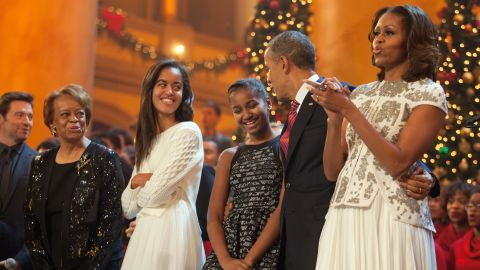 """The first family sings during the finale of TNT's """"Christmas in Washington"""" program in December 2013. Michelle Obama's mother, Marian Robinson, and the program's host, actor Hugh Jackman, are at left. Time Warner is the parent company of TNT and CNN."""
