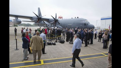 Media and spectators gather around a newly built Lockheed MC-130J Super Hercules Commando II. Lockheed Martin held a news conference at its factory to mark the 60th anniversary of its military transport plane, the C-130 Hercules, on Tuesday, April 7, in Marietta, Georgia. The C-130 family of planes is the longest continuously produced military plane in history. Click through the gallery to see more photos.
