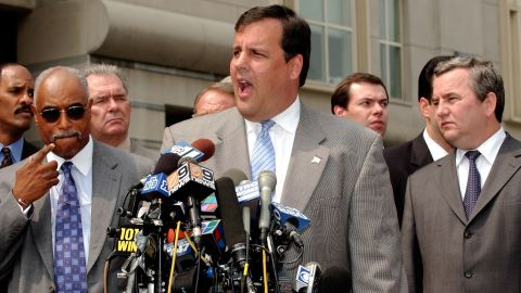 Christie speaks to the media about an FBI sting with Russian Gen. Sergei Fomenko, right, of the Federal Security Service and FBI Agent Louie Allen on August 13, 2003, in Newark, New Jersey.