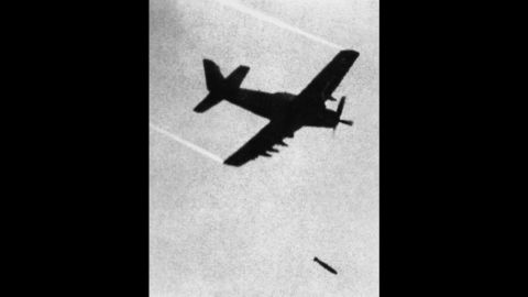 """In this June 8, 1972 file photo taken by Associated Press photographer Huynh Cong """"Nick"""" Ut, a Skyraider, a propeller driven plane of the Vietnamese Airforce (VNAF) 518th Squadron, drops one bomb with incendiary napalm and white phosphorus jelly over Trang Bang village. It only took a second for Ut to snap the iconic black-and-white image of 9-year-old Phan Thi Kim Phuc, one of the victims of the napalm attack in 1972, but it communicated the horrors of the Vietnam War in a way words could never describe, helping to end one of America's darkest eras."""