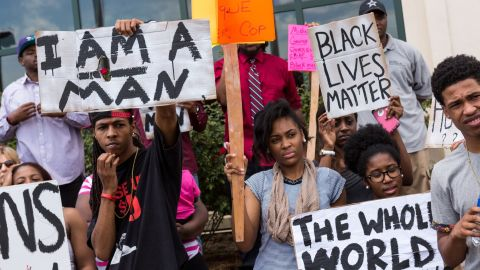 """Some of those rallying outside North Charleston's City Hall held signs and wore shirts that said """"Black lives matter."""" Scott was black. Slager is white."""