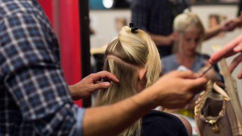 Caption:Coiffeur Fis Uka styles the hair of Veronica at Udo Walz' salon in Berlin on July 10, 2013. AFP PHOTO / JOHANNES EISELE (Photo credit should read JOHANNES EISELE/AFP/Getty Images)