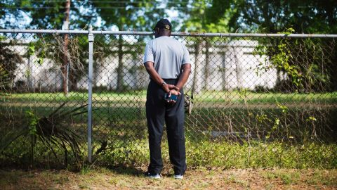 """Joe Gilliard looks over a fence April 9, 2015, at the spot where Walter Scott was shot and killed by a police officer April 4 in North Charleston, South Carolina. The officer, <a href=""""http://www.cnn.com/2015/04/08/us/south-carolina-michael-slager/index.html"""" target=""""_blank"""">Michael Slager</a>, has been charged with murder in the fatal shooting of<a href=""""http://www.cnn.com/2015/04/08/us/south-carolina-who-was-walter-scott/index.html"""" target=""""_blank""""> Scott</a>, an unarmed 50-year-old. Video captured by a bystander showed Slager shooting Scott as he ran away."""