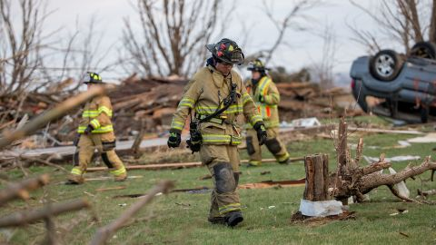 Firefighters search for unaccounted people on Friday, April 10, a day after a tornado swept through Fairdale, Illinois. Geraldine M. Schultz, 67, was killed when the tornado tore through town, according to Dennis Miller with the DeKalb County coroner. As many as 14 tornadoes were reported in the rural Midwest on Thursday.
