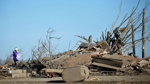 Candy Trudell looks through the wreckage of her home in Rochelle on April 10.