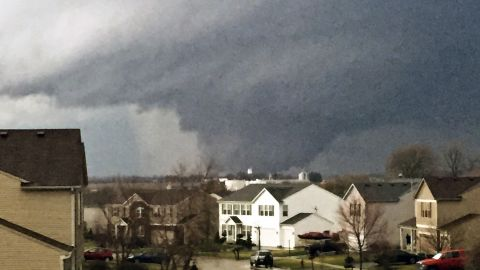 A tornado is seen from a home in Kirkland, Illinois, on April 9.