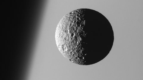 """Mimas, the smallest and closest of Saturn's eight main moons, is heavily cratered and has a low density that suggests it is mostly <a href=""""http://saturn.jpl.nasa.gov/science/moons/mimas/"""" target=""""_blank"""" target=""""_blank"""">composed of water ice</a>. The moon's main 88-mile-long crater makes it resemble """"Death Star"""" from """"Star Wars Episode IV.""""  <br />"""