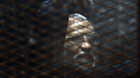 The Muslim Brotherhood's Mohamed Badie appears behind bars during a trial last year in Cairo.