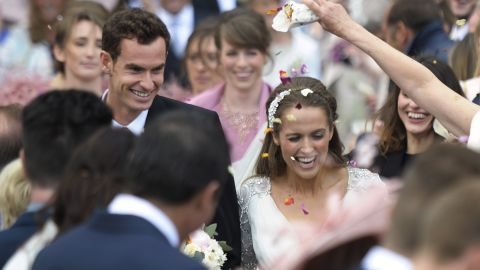 British tennis player Andy Murray and his new wife Kim Sears smile as they are showered in confetti after being married at Dunblane Cathedral on April 11, 2015. Tennis ace Andy Murray married his long-term girlfriend Kim Sears at Dunblane's 12th century cathedral today bringing his Scottish hometown to a standstill.