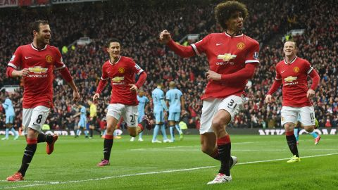 Marouane Fellaini (2nd R) celebrates after putting Manchester United 2-1 ahead in the derby against City at Old Trafford.