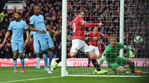 Sergio Aguero had put City ahead in the eighth minute, but Young (out of picture) leveled on 14 as he beat England keeper Joe Hart.