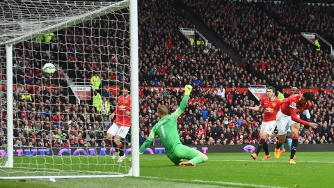 Chris Smalling (right) headed United's fourth goal from Young's free-kick.