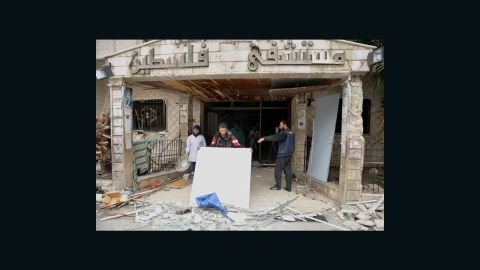 People clear rubble from the hospital. One aid worker told CNN that the locals are struggling to survive without medical care, food, and access to clean drinking water.