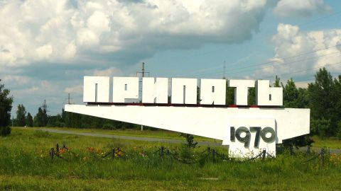 Welcome to Pripyat. The sign reads 'Pripyat' and gives the town's foundation year, 1970.