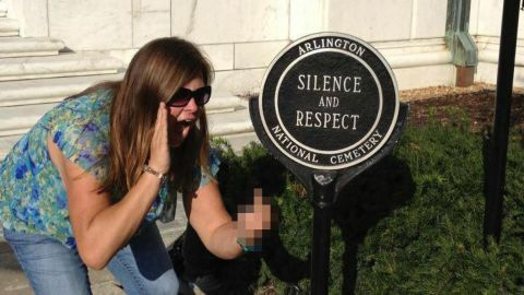 """After this picture of Lindsey Stone at Arlington National Cemetery went viral, she was fired from a job working with autistic children and fell into a depression. """"Literally, overnight everything I knew and loved was gone,"""" she told Jon Ronson. In a statement, <a href=""""https://www.facebook.com/LEWTFM/posts/551008271580695"""" target=""""_blank"""" target=""""_blank"""">she apologized</a>: """"We never meant to cause any harm or disrespect to anyone, particularly our men and women in uniform,"""" she said. Ronson later helped her adjust her Google search results."""