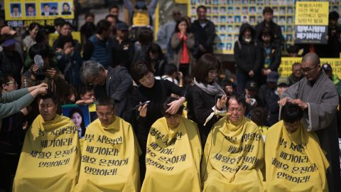 Relatives of victims of the Sewol ferry accident have their heads shaved during a protest in Seoul on April 2, 2015.