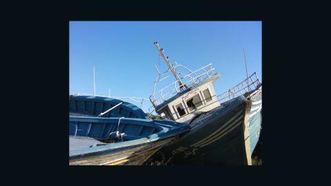 People smugglers' boats lie abandoned on the Italian island of Lampedusa.