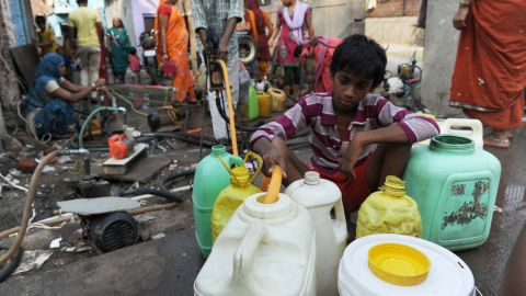 An Indian resident fills up water containers using a hand pump in New Delhi on June 4, 2013. With summer temperatures hovering around 45 degrees, residents are struggling as the city has been going through a severe water shortage. AFP PHOTO/ SAJJAD HUSSAIN        (Photo credit should read SAJJAD HUSSAIN/AFP/Getty Images)