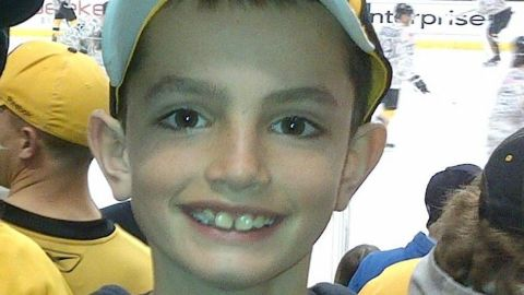 """<strong>Martin Richard, </strong>8, was in the second grade and loved the Red Sox. He was the middle of three children and is best known for a school project in which he made a poster with a peace sign and the words """"No more hurting people."""" He was less than 4 feet from the second bomb. He bled to death as his mother leaned over him, begging him to live."""