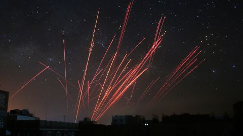 The sky over Sanaa, Yemen, is illuminated by anti-aircraft fire during a Saudi-led airstrike on Friday, April 17.