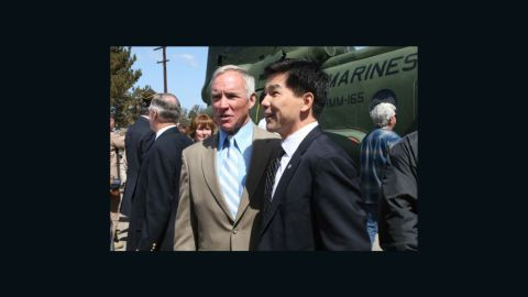 Retired Marine pilot Col. Gerry Berry, left, stands with Quang Pham, who became a Marine pilot himself after Berry evacuated him from South Vietnam at 9.