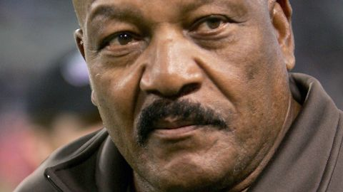 Hall of Famer Jim Brown watches from the sidelines as the Baltimore Ravens defeat the Cleveland Browns 27-13 on November 7, 2004, at M&T Bank Stadium in Baltimore, Maryland.
