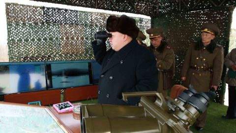 Kim inspects a drill for seizing an island at an undisclosed location in North Korea in an undated picture released by North Korea's official Korean Central News Agency on February 21.