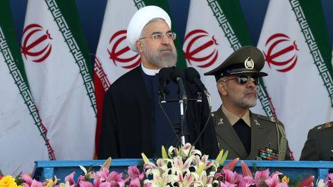 Iranian President Hassan Rouhani reviews the parade April 18.