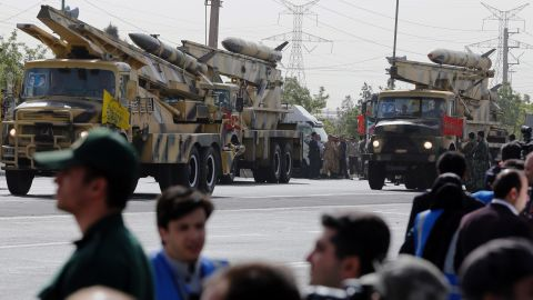 Mid-range Zelzal missiles are driven through the parade outside Tehran.