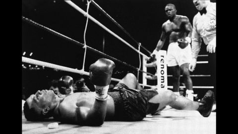 """""""Buster"""" Douglas was responsible for what is seen my many as boxing's single greatest upset.  <br /><br />In 1990 the journeyman from Columbus, Ohio challenged Mike Tyson having only fought for a title once in his career -- a loss to Tony Tucker for the IBF Heavyweight strap. Tyson was in imperious form, undefeated in 37 fights and holder of the WBA, WBC and IBF titles.<br /><br />Douglas' mother had died during his training camp and he entered the ring a heavy 42-1 against, with many casinos not even allowing bets to be placed. However the man from Ohio dominated, closing Tyson's left eye in the fifth round. Tyson rallied with a knockdown in the eighth, but was floored by Douglas in the 10th, flat out and unable to recover, the first and most shocking defeat of his career.<br />"""