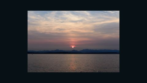 Tim Durkan noticed the fiery sunsets, and photographed them from different spots round Seattle.