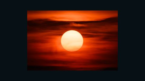 A reddish sun warms the Seattle skyline. The intense sunsets in the Pacific Northwest over the weekend were the result of smoke from wildfires burning in Siberia.