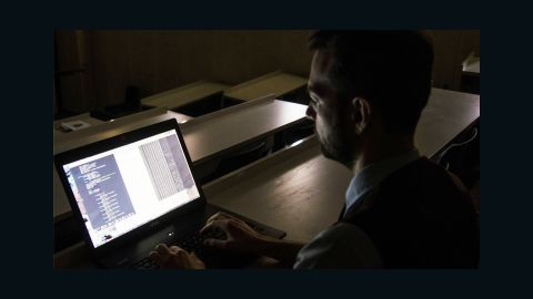 Digital forensic expert Joshua James looks over malicious hacking codes used in a highly aggressive attack in South Korea in 2013.
