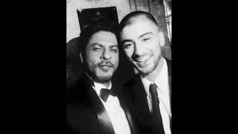 """Shah Rukh Kahn, an actor nicknamed the """"King of Bollywood,"""" <a href=""""https://twitter.com/iamsrk/status/589164454480191488"""" target=""""_blank"""" target=""""_blank"""">tweeted a selfie</a> with former One Direction star Zayn Malik, right, at the Asian Awards in London on Friday, April 17. """"This kid is so cool,"""" Khan said. """"May Allah bless him."""" It has already been retweeted 110,000 times."""