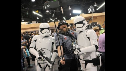 """A man takes a selfie with Stormtroopers during a """"Star Wars"""" celebration Thursday, April 16, in Anaheim, California."""